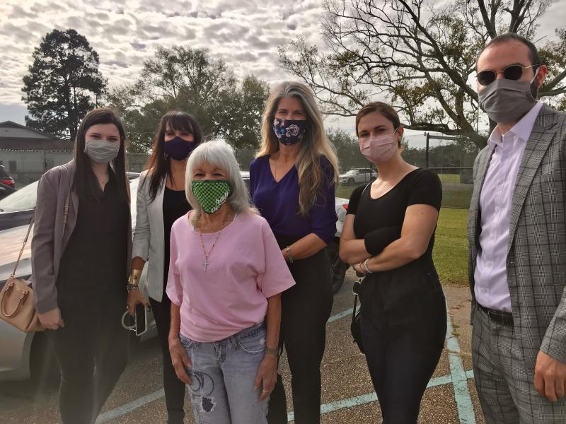 Student Attorneys and Supervising Attorneys stand with newly-released client outside Louisiana Correctional Institute for Women
